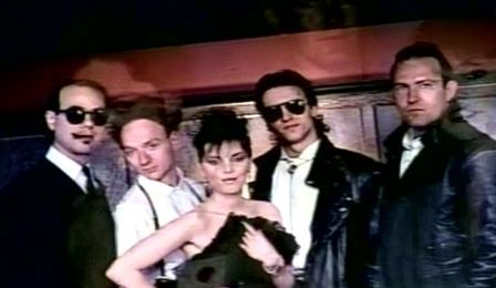 pat, NEIL, and band on set of lipstick lies video